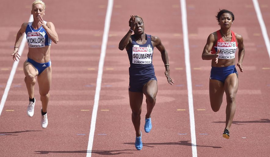 Greece's Yeoryia Kokloni, France's Myriam Soumare and Norway's Ezinne Okparaebo, from left, compete in a women's 100m first round heat during the European Athletics Championships in Zurich, Switzerland, Tuesday, Aug. 12, 2014. (AP Photo/Martin Meissner)