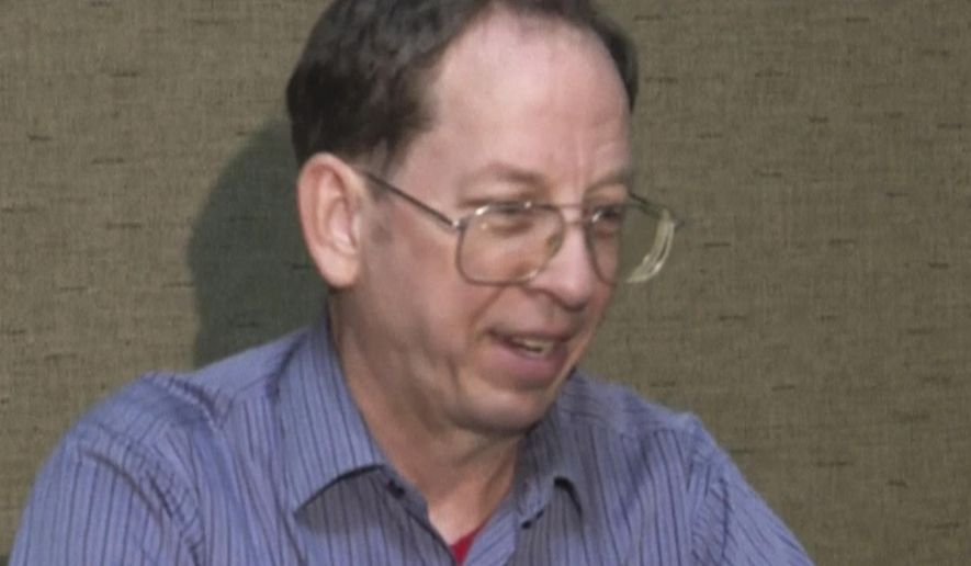 """FILE - In this Friday, Aug. 1, 2014, file image taken from video, U.S. citizen Jeffrey Edward Fowle, of Miamisburg, Ohio, speaks at an undisclosed location in North Korea. The family of Fowle, who has been charged with """"anti-state"""" crimes in North Korea, is expected to attend a news conference on Tuesday, Aug. 12, 2014, in an effort to help his case, about 10 days after he pleaded with the U.S. government to intervene. (AP Photo/APTN, File)"""