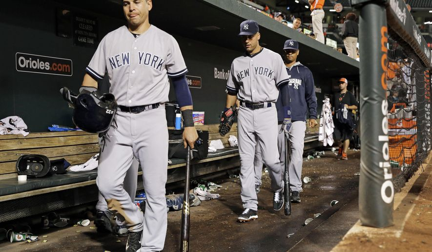 New York Yankees' Jacoby Ellsbury, left, and Derek Jeter walk out of the dugout after a baseball game against the Baltimore Orioles, Monday, Aug. 11, 2014, in Baltimore. Baltimore won 11-3. (AP Photo/Patrick Semansky)