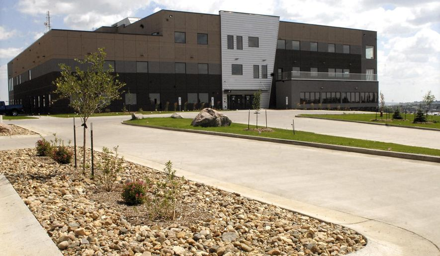This Aug. 11, 2014 photo shows the new $17 million, 85,000 square-foot building that the North Dakota Information Technology Department recently moved into in Bismarck, N.D.  Employees had been spread among five Bismarck locations, including the state Capitol. The move to the new 85,000-square-foot facility frees up about 10,000 square feet of space inside the Capitol that will be used by other agencies. (AP Photo/The Bismarck Tribune, Mike McCleary)