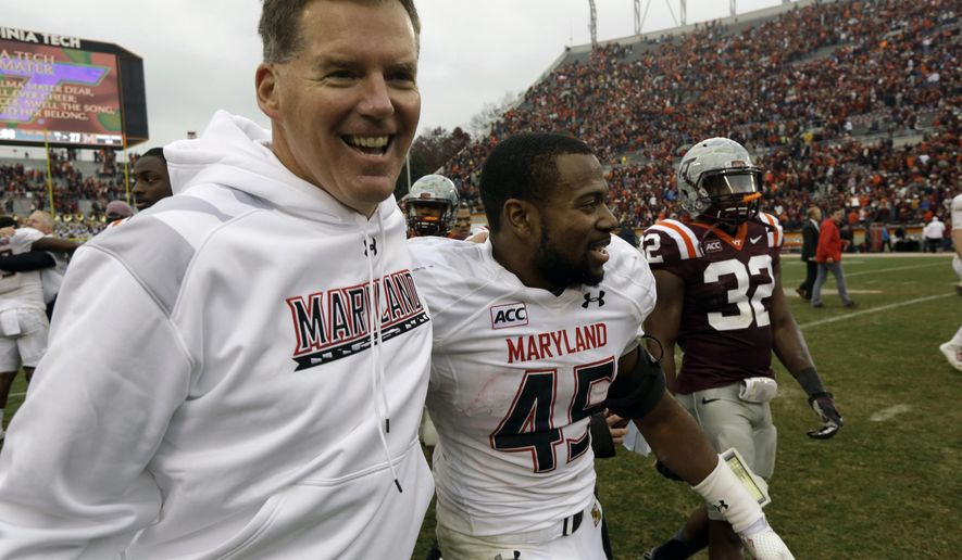 FILE - In this Nov. 16, 2013, file photo, Maryland head coach Randy Edsall, left, celebrates with Maryland running back Brandon Ross (45) after their team's 27-24 overtime win over Virginia Tech in an NCAA college football game in Blacksburg, Va. Coming off its best season under coach Edsall, Maryland can't wait to mix it up on the football field with Big Ten powerhouses Ohio State, Michigan and Michigan State (AP Photo/Steve Helber, File)