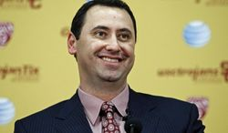 FILE - In this Dec. 3, 2013 file photo, newly-hired University of Southern California football head coach Steve Sarkisian smiles at his introcuctory news conference in Los Angeles.  With NCAA sanctions nearly finished and a sparkling new training complex on campus, the former Washington coach believes it's time for USC to regain its spot atop the Pac-12. (AP Photo/Jae C. Hong, File)