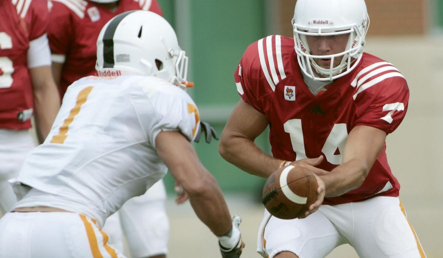 Tennessee quarterback Justin Worley (14) hands off the ball to running back Jalen Hurd (1) while running drills during NCAA college football practice in Knoxville, Tenn., Friday, Aug. 8, 2014. (AP Photo/The Daily Times, Daryl Sullivan) MANDATORY CREDIT