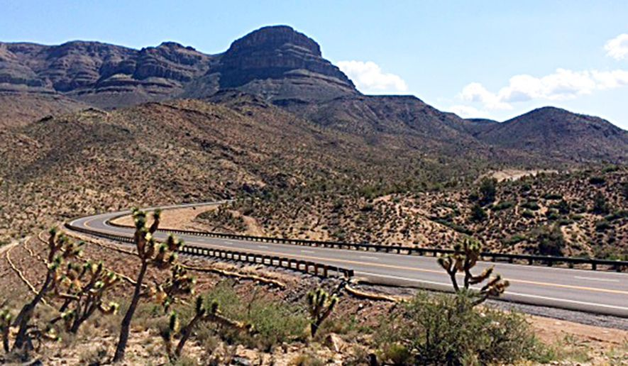 CORRECTS RESERVATION LOCATION TO NORTHWEST ARIZONA- This undated photo provided by Fann Contracting, Inc. shows a newly-paved stretch of road leading to the Grand Canyon Skywalk on the Hualapai Indian Reservation in northwestern Arizona. Known as the Diamond Bar Road, the once rugged, nine-mile washboard road now is completely paved after years of battles that included a dude rancher charging tourists to cross his property. A ceremony is planned Tuesday, Aug. 12, 2014 to mark completion of the project. (AP Photo/Fann Contracting, Inc.)