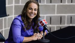 WNBA star Becky Hammon takes questions from the media at the San Antonio Spurs practice facility after being introduced as an assistant coach with the team on Tuesday, Aug. 5, 2014 in San Antonio. Hammon became the first woman to be a full-time, paid assistant on an NBA staff. (AP Photo/Bahram Mark Sobhani)
