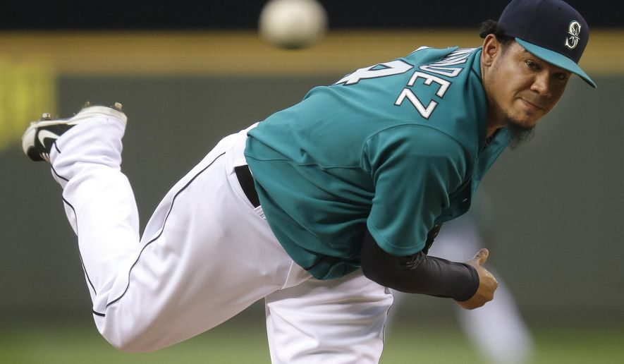 Seattle Mariners starting pitcher Felix Hernandez watches a pitch against theToronto Blue Jays in the fourth inning of a baseball game, Monday, Aug. 11, 2014, in Seattle. (AP Photo/Ted S. Warren)