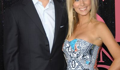"""New York Giants quarterback Eli Manning and wife Abigal McGrew attend the premiere of """"Sex and the City"""" at Radio City Music Hall on Tuesday, May 27, 2008 in New York City. (AP Photo/Evan Agostini)"""