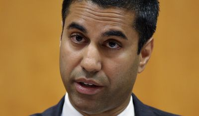 File - In this Aug. 9, 2013 file photo, FCC Commissioner Ajit Pai presents his dissent during a Federal Communications Commission (FCC) hearing at the FCC in Washington. (AP Photo/Susan Walsh, file)
