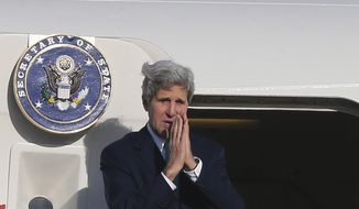** FILE ** U.S. Secretary of State John Kerry holds hands to bid farewell in Sydney, Australia, Wednesday, Aug. 13, 2014. (AP Photo/Rob Griffith, Pool)