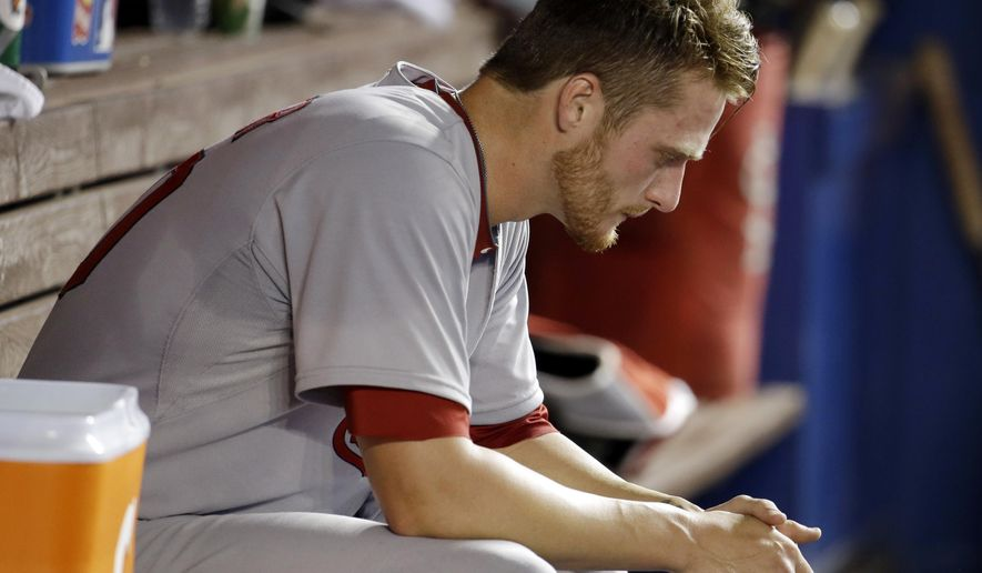 St. Louis Cardinals starting pitcher Shelby Miller sits in the dugout after pitching in the fourth inning during a baseball game against the Miami Marlins, Monday, Aug. 11, 2014, in Miami. (AP Photo/Lynne Sladky)