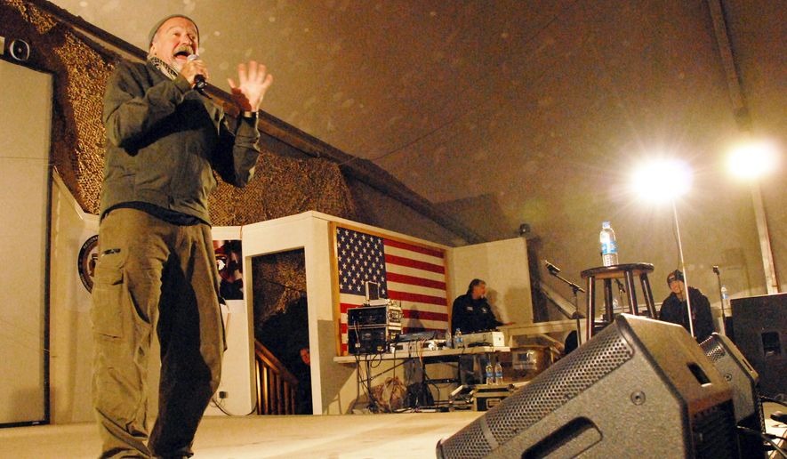 This Dec. 15, 2010 photo released by the U.S. Department of Defense shows actor-comedian Robin Williams performing for a USO tour at Bagram Airfield in Afghanistan. Members of the armed forces have long held special affection for Williams, 63, who died Monday, Aug. 11, 2014 after hanging himself in his San Francisco Bay Area home. Williams never served in the military, but he was a tireless participant in USO shows. (AP Photo/U.S. Department of Defense, U.S. Army Spc. Adam L. Mathis, 17th Public Affairs Detachment)