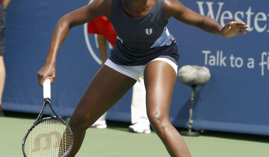Venus Williams waits for a shot from Lucie Safarova, from Czech Republic, during a first round match at the Western & Southern Open tennis tournament, Tuesday, Aug. 12, 2014, in Mason, Ohio. (AP Photo/David Kohl)