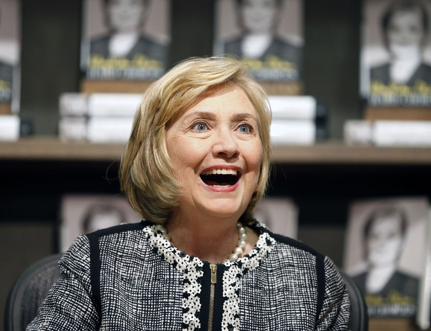 """Former Secretary of State Hillary Rodham Clinton, after criticizing President Obama's foreign policy, said through a spokesman Tuesday that she looks forward to """"hugging it out"""" with the president at a party Wednesday.  (AP Photo/Mike Groll, File)"""