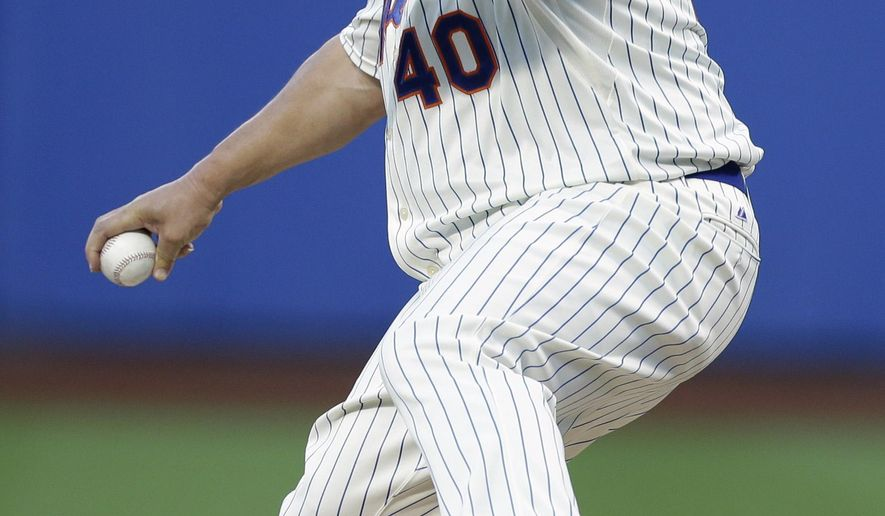 New York Mets' Bartolo Colon (40) delivers a pitch during the first inning of a baseball game against the Washington Nationals Wednesday, Aug. 13, 2014, in New York.  (AP Photo/Frank Franklin II)