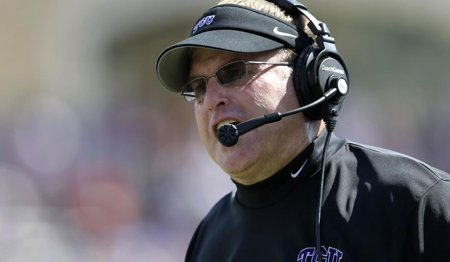 FILE - In this Oct. 12, 2013, file photo, TCU head coach Gary Patterson instructs his  team from the sideline in the second half of an NCAA college football game against Kansas in Fort Worth, Texas.  Patterson is coming off his second losing season in 13 seasons as TCU's head coach. (AP Photo/Tony Gutierrez, file)