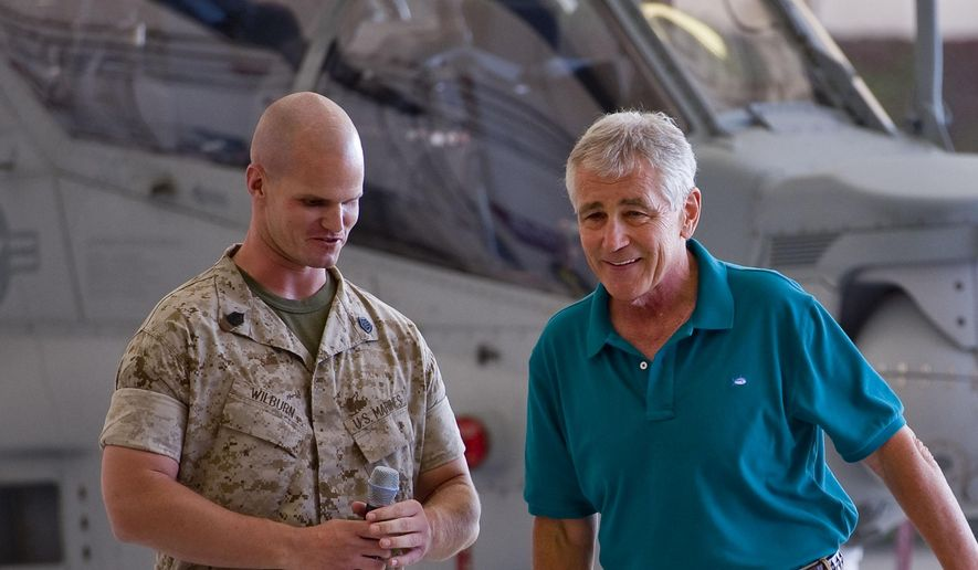 Secretary of Defense Chuck Hagel, right, takes a question from Gunnery Sgt. Wilburn Jeffrey during a question and answer period with Marines at Camp Pendleton on Tuesday Aug. 12, 2014. Hagel announced the deployment of another 130 U.S. troops to Iraq in remarks to Marines at this Southern California base on the final stop of a weeklong, around-the-world trip that also took him to India, Germany and Australia. (AP Photo/The Orange County Register, Paul Rodriguez)