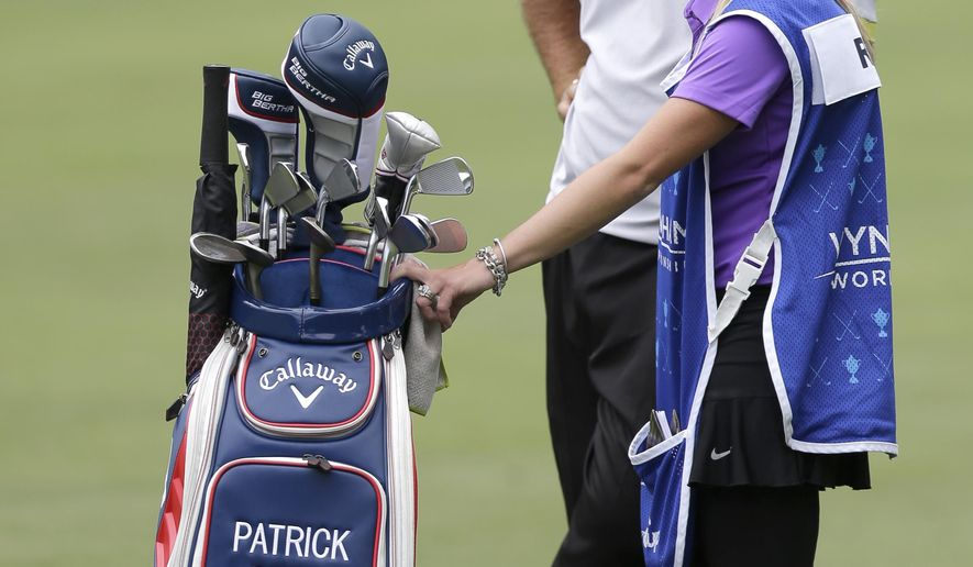 Defending champion Patrick Reed, back, waits with his wife and caddie, Justine, to hit on the sixth hole during the pro-am for the Wyndham Championship golf tournament in Greensboro, N.C., Wednesday, Aug. 13, 2014. (AP Photo/Chuck Burton)