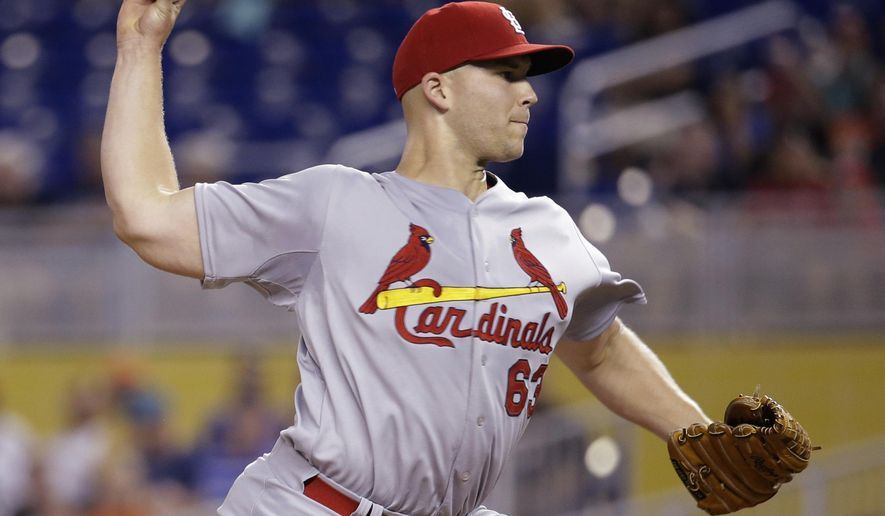 St. Louis Cardinals starting pitcher Justin Masterson throws in the first inning during a baseball game against the Miami Marlins, Wednesday, Aug. 13, 2014, in Miami. (AP Photo/Lynne Sladky)