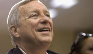 U.S. Senate Majority Whip Dick Durbin acknowledges applause from the crowd of supporters at the Illinois Democratic County Chairmen's Association's annual state fair Governor's Day brunch on Wednesday, Aug. 13, 2014, in Springfield, Ill.  (AP Photo/Seth Perlman)