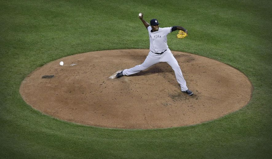 New York Yankees starting pitcher Michael Pineda throws to the Baltimore Orioles in the third inning of a baseball game, Wednesday, Aug. 13, 2014, in Baltimore. (AP Photo/Patrick Semansky)