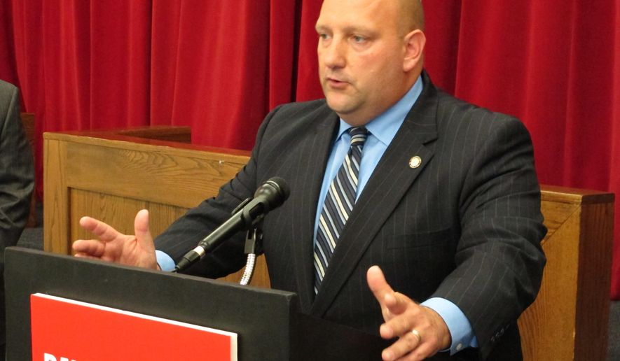 State Rep. Nick Barborak, D-Lisbon, calls for passage of his bill that would loosen state sentencing law to send more drug dealers to prison, Wednesday, Aug. 13, 2014, in Columbus, Ohio. Barborak says the 2011 law is preventing judges from sentencing some drug dealers to prison at a time the state's heroin epidemic is worsening. (AP Photo/Andrew Welsh-Huggins)