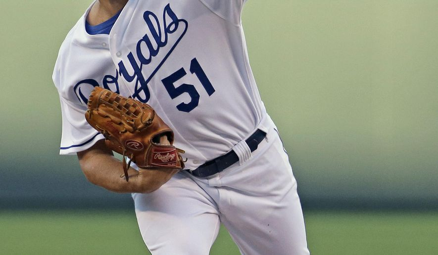 Kansas City Royals starting pitcher Jason Vargas throws during the first inning of a baseball game against the Oakland Athletics Wednesday, Aug. 13, 2014, in Kansas City, Mo. (AP Photo/Charlie Riedel)