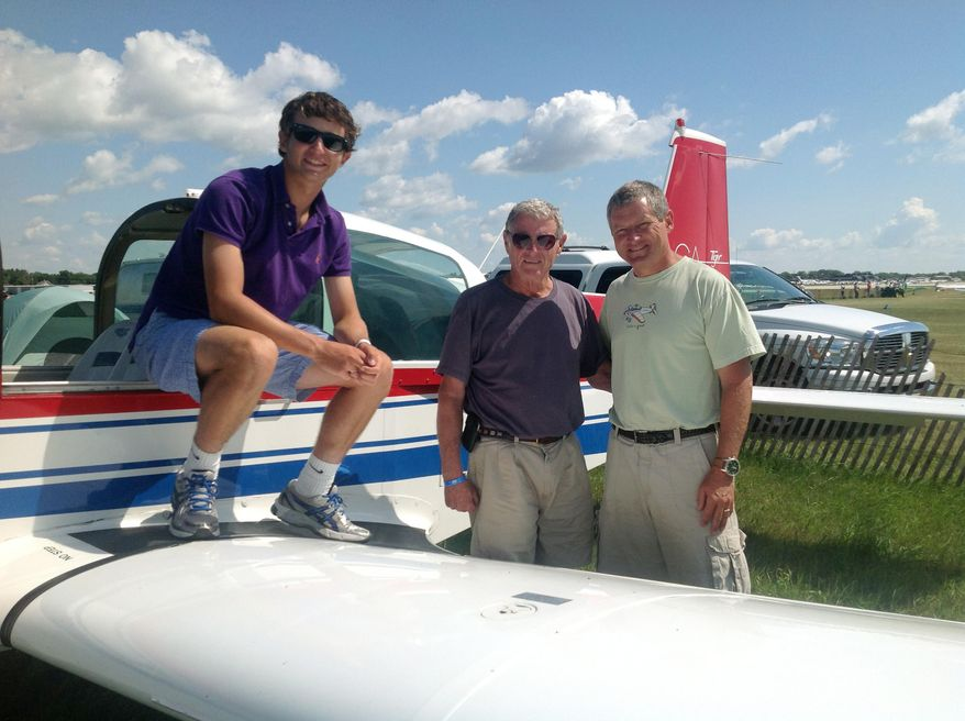FILE - This Aug. 1, 2013 file photo, courtesy of Sen. James Inhofe, R-Okla., shows, from left, Inhofe's grandson, Cole Inhofe, Sen. Inhofe, and Inhofe's son Perry Inhofe, in Oshkosh, Wis. Perry Inhofe was flying a new type of aircraft for the first time alone when he was killed last November in a plane crash, according to a factual report released this week by the National Transportation Safety Board. (AP Photo/Courtesy of Sen. James Inhofe, Ryan Jackson, File)