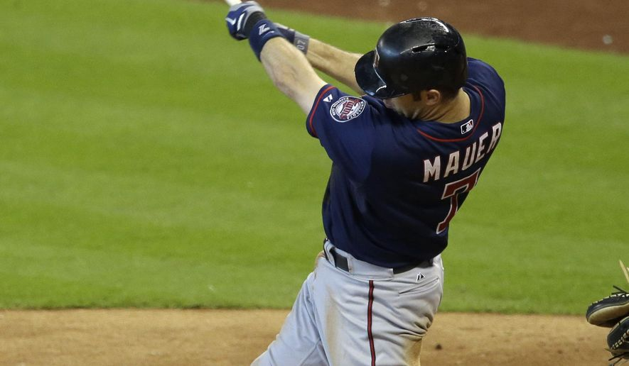 Minnesota Twins' Joe Mauer swings for a solo home run against the Houston Astros in the sixth inning of a baseball game Wednesday, Aug. 13, 2014, in Houston. (AP Photo/Pat Sullivan)