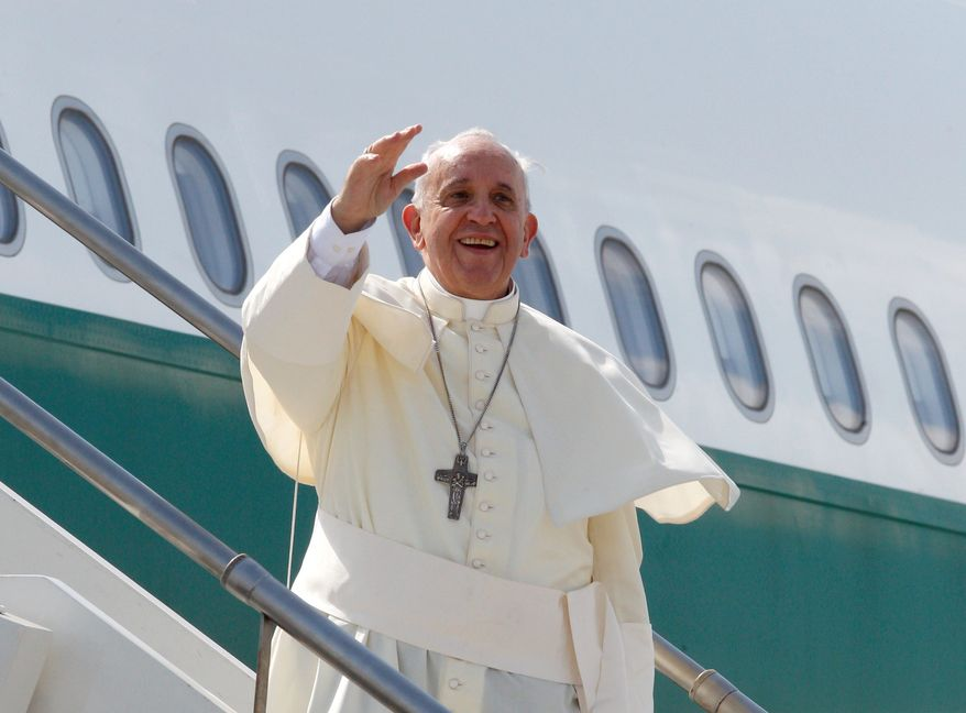 Pope Francis boards a plane on his way to South Korea from Rome's Fiumicino International Airport Wednesday. His five-day visit marks the first time in a quarter-century that a pope has traveled to the divided Korean peninsula. The pontiff plans to bring a message of peace and reconciliation to all Koreans. (associated press)