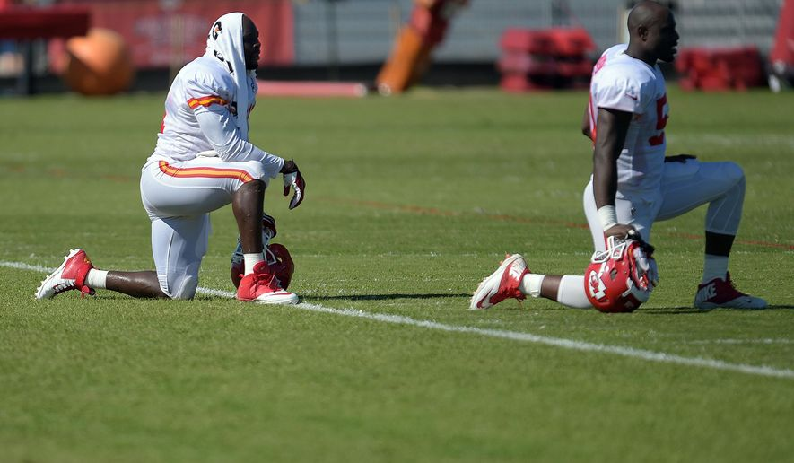 Kansas City Chiefs' Tamba Hali (91) and Justin Houston (50) rest between drills during practice Wednesday morning Aug. 13, 2014,  on the Missouri Western State University campus in St. Joseph. Mo. (AP Photo/St. Joseph News-Press, Todd Weddle)