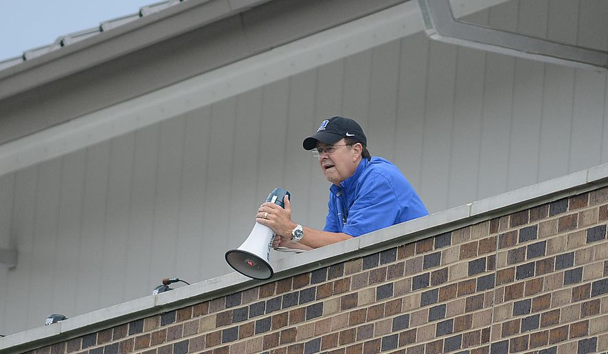 Duke head coach David Cutcliffe watches a scrimmage on the Brooks Practice Field from the top of the Pascal Field House Monday, Aug. 11, 2014, during a Duke football practice, in Durham N.C.  (AP Photo/The Herald-Sun, Bernard Thomas)