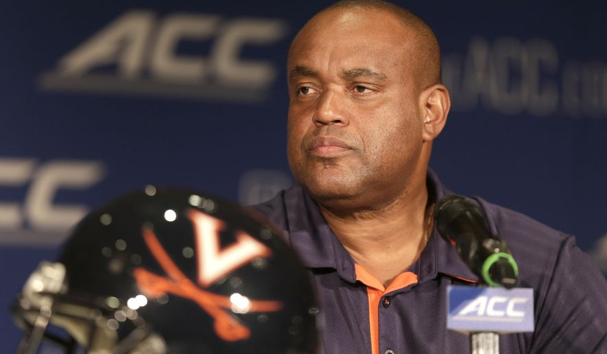 FILE - In this July 21, 2014, file photo, Virginia head coach Mike London answers a question during a news conference at the Atlantic Coast Conference Football kickoff in Greensboro, N.C. (AP Photo/Chuck Burton, File)
