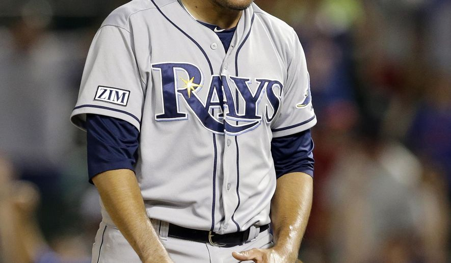 Tampa Bay Rays relief pitcher Cesar Ramos yells out after walking Texas Rangers' Adam Rosales with bases loaded in the 14th inning of a baseball game, Tuesday, Aug. 12, 2014, in Arlington, Texas. Nick Martinez scored on Rosales walk in the 3-2 Rangers win. (AP Photo/Tony Gutierrez)