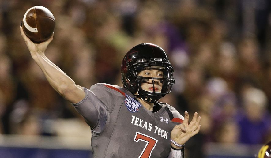 FILE - In this Dec. 30, 2013, file photo, Texas Tech quarterback Davis Webb throws a pass during his record setting first half against Arizona State during  the Holiday Bowl NCAA college football football game in San Diego.  Webb will be the starting quarterback this season.  (AP Photo/Gregory Bull, File)