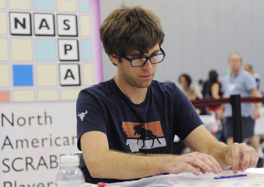 """Conrad Bassett-Bouchard opens with the word """"zilch"""" during the championship round Wednesday, Aug. 13, 2014, at the 25th National Scrabble Championships in Buffalo, N.Y. Conrad went on to win the title. (AP Photo/Gary Wiepert)"""