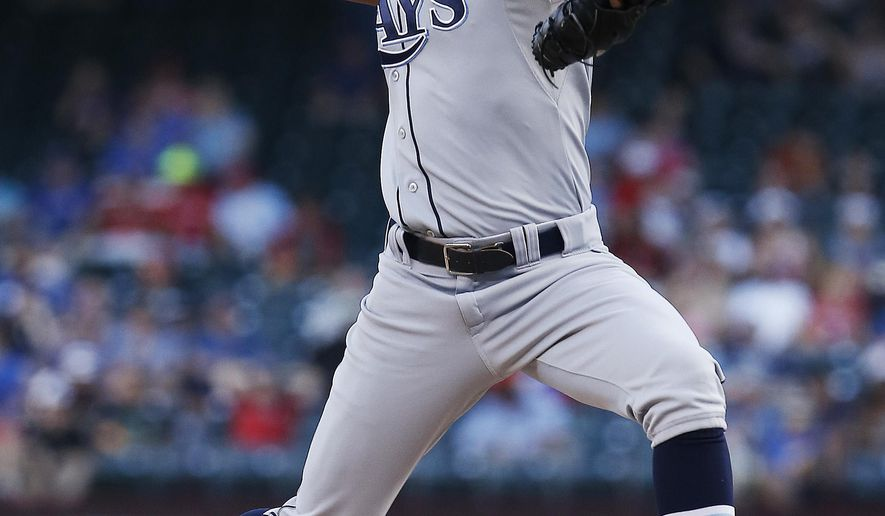 Tampa Bay Rays starting pitcher Chris Archer (22) throws during the first inning of a baseball game against the Texas Rangers, Wednesday, Aug. 13, 2014, in Arlington, Texas. (AP Photo/Brandon Wade)