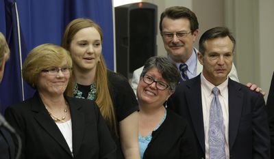 Plaintiffs in the federal suit over Virginia's ban on gay marriage, from left: Mary Townley, Emily Schall-Townley, Carol Schall, Tony London and Tim Bostic.  (AP Photo/Steve Helber)