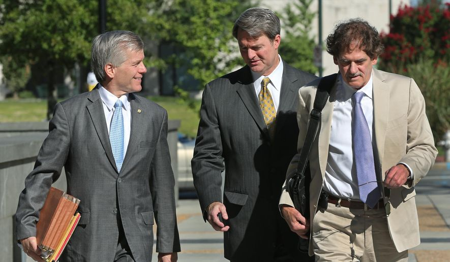 "Former Virginia Gov. Bob McDonnell, left, arrives with his attorneys, John L. Brownlee, center, and Henry W. ""Hank"" Asbill at the federal courthouse in Richmond, Va., Thursday, Aug. 14, 2014, for the corruption trial against McDonnell and his wife, Maureen McDonnell. (AP Photo/Richmond Times-Dispatch, P. Kevin Morley)"