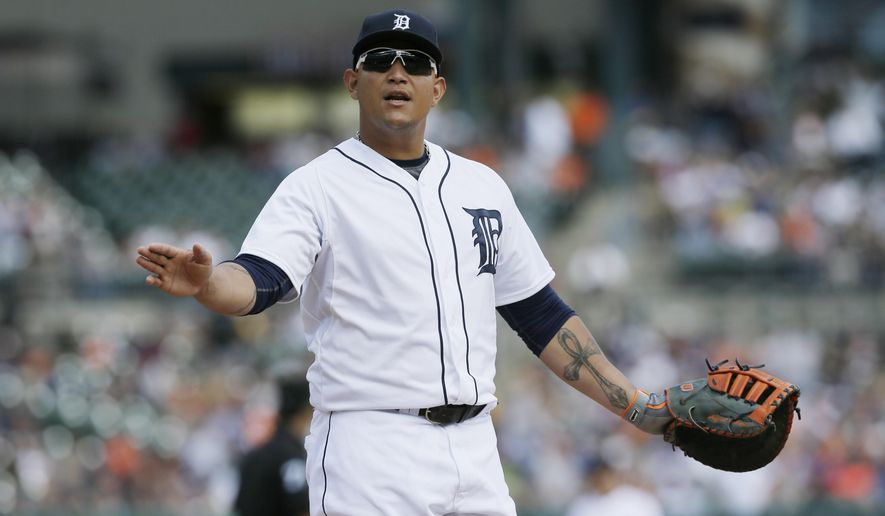 Detroit Tigers first baseman Miguel Cabrera signals for fans to calm down as they booed the two-run home run by Pittsburgh Pirates' Gaby Sanchez during the ninth inning of an interleague baseball game, Thursday, Aug. 14, 2014 in Detroit. (AP Photo/Carlos Osorio)
