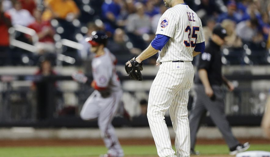 New York Mets starting pitcher Dillon Gee reacts as Washington Nationals' Bryce Harper, left, runs the bases after hitting a two run home run during the fourth inning of a baseball game Thursday, Aug. 14, 2014, in New York. (AP Photo/Frank Franklin II)