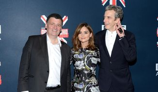 """Executive producer and writer Steven Moffat, left, actress Jenna Coleman and actor Peter Capaldi attend BBC America's """"Doctor Who"""" premiere fan screening at the Ziegfeld Theatre on Thursday, Aug. 14, 2014, in New York. (Photo by Evan Agostini/Invision/AP)"""