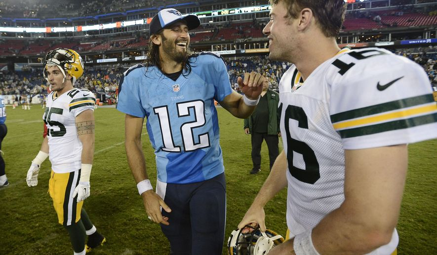 Tennessee Titans quarterback Charlie Whitehurst (12) talks with Green Bay Packers quarterback Scott Tolzien (16) after the Titans defeated the Packers 20-16 in a preseason NFL football game Saturday, Aug. 9, 2014, in Nashville, Tenn. (AP Photo/Mark Zaleski)