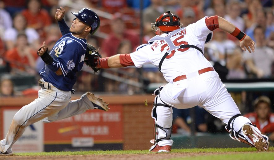 St. Louis Cardinals' A.J. Pierzynski (35) tags out San Diego Padres' Alexi Amarista at the plate in the ninth inning in a baseball game, Thursday, August 14, 2014, at Busch Stadium in St. Louis. (AP Photo/Bill Boyce)
