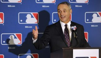 Major League Baseball Chief Operating Officer Rob Manfred speaks to reporters after team owners elected him as the next commissioner of Major League Baseball during an owners quarterly meeting in Baltimore, Thursday, Aug. 14, 2014. (AP Photo/Steve Ruark) **FILE**