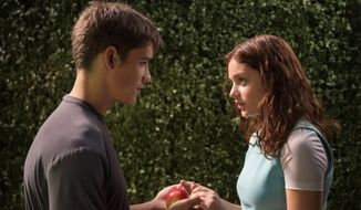 "Brenton Thwaites and Odeya Rush star in ""The Giver."""