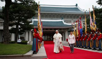 South Korean President Park Geun-hye and Pope Francis walk together before a welcoming ceremony at the presidential Blue House in Seoul. Pope Francis became the first pontiff in 25 years to visit South Korea. (Associated Press)