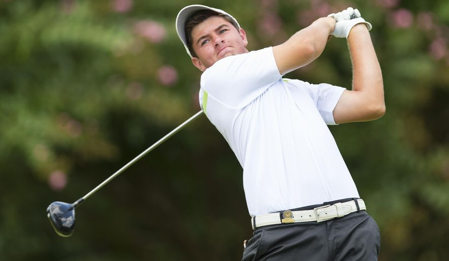 Cameron Young, from Scarborough, N.Y., watches his tee shot on the second hole during the third round of match play at the 2014 U.S. Amateur golf tournament at Atlanta Athletic Club in Johns Creek, Ga., Thursday, Aug. 14, 2014.  (AP Photo/USGA, Chris Keane)