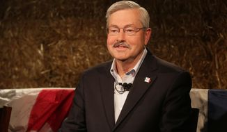 Iowa Gov. Terry Branstad smiles during a debate with Sen. Jack Hatch during the Iowa State Fair on Thursday, Aug. 14, 2014, in Des Moines. (AP Photo/The Des Moines Register, Bryon Houlgrave)
