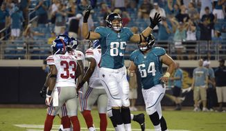 Jacksonville Jaguars tight end Matt Veldman (85) celebrates after catching a pass in the end zone for a two-point conversion during the second half of an NFL preseason football game against the New York Giants Friday, Aug. 10, 2012, in Jacksonville, Fla. (AP Photo/Phelan M. Ebenhack)