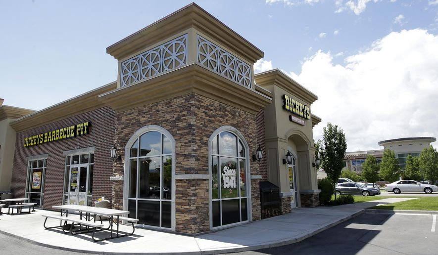 Dickey's Barbecue Pit is shown Thursday, Aug. 14, 2014, in South Jordan, Utah. Police say a woman was in extremely critical condition after drinking sweet tea laced with an industrial cleaning chemical at Dickey's Barbecue Pit. South Jordan Police Cpl. Sam Winkler says the 67-year-old woman was eating at Dickey's Barbecue Pit on Sunday when she poured herself a glass of tea from the beverage bar. Winkler says the woman took a sip and her mouth started burning. (AP Photo/Rick Bowmer)
